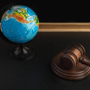 Wooden gavel and globe.
